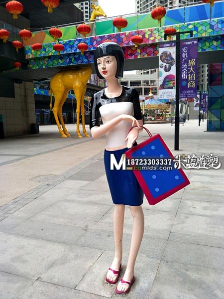 重庆玻璃钢雕塑人物提包女人